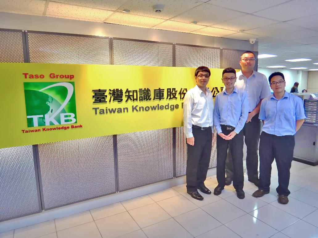 Group picture of TKB CFO Yuan-Hung Fang (second from right) and colleagues, sharing business operation benefits produced by information systems.